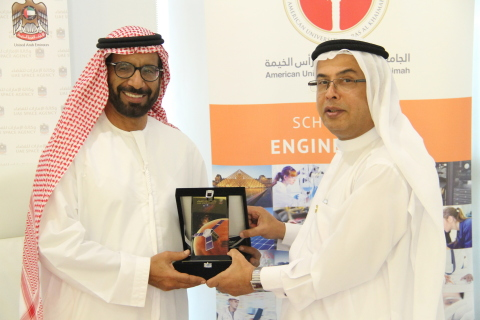 Professor Al Alkim and H. E. Dr. Al Romaithi exchange tokens of appreciation following the signing o ...