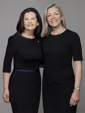 Manhattan real estate veteran Ellie Johnson (left) and Candace Adams, CEO of Berkshire Hathaway HomeServices New England Properties/Westchester Properties, commemorate the launch of Berkshire Hathaway HomeServices New York Properties. Johnson leads the new brokerage as its president. (Photo: Business Wire)