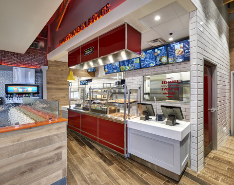 Colored crocks replace steel warming trays to give the food display area a more inviting appearance, with increased use of glass adding to the visual appeal. (Photo: Bojangles')