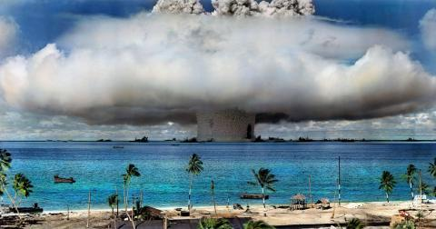 A nuclear weapon is detonated at Bikini Atoll in the Marshall Islands in 1946. (Image has been color ...