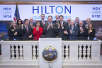 Executives and guests of Hilton Grand Vacations (NYSE:HGV) visit the New York Stock Exchange (NYSE) to celebrate their spin-off from Hilton (NYSE:HLT). To mark the occasion President and Chief Executive Officer of Hilton Grand Vacations, Mark Wang, rings the Opening Bell. (Photo Credit: NYSE)