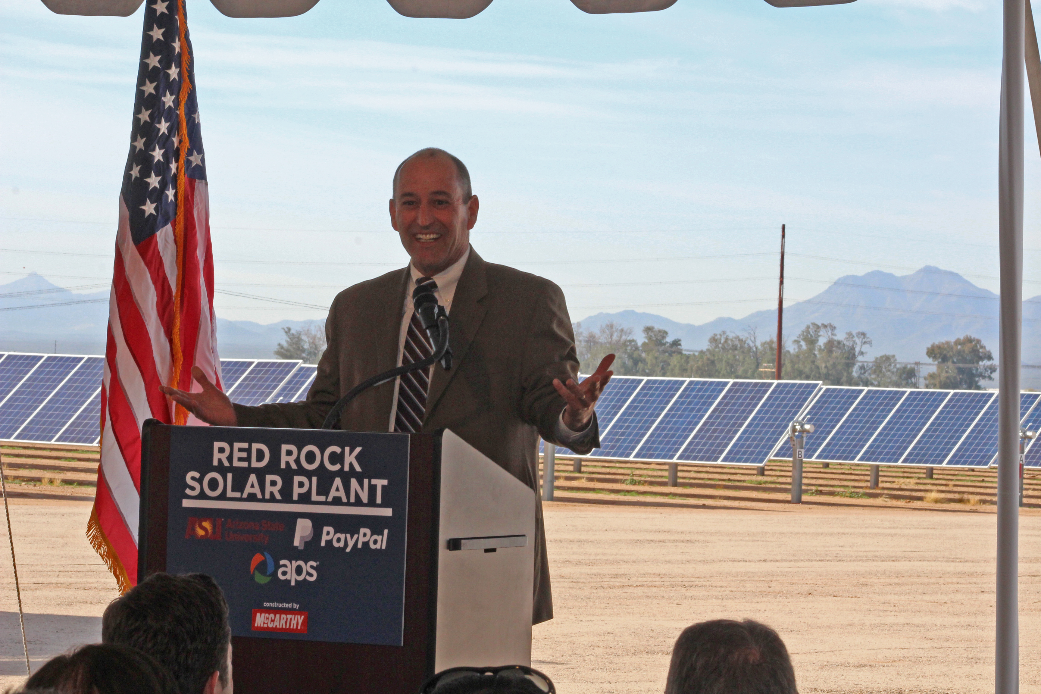"""Daniel Froetscher, APS Senior Vice President of Transmission, Distribution and Customers, helped unveil the Red Rock Solar Plant to the public today. APS developed and will own and operate the 40-megawatt photovoltaic plant, located 30 miles south of Casa Grande in Red Rock, Ariz. Arizona State University (ASU) and PayPal will purchase renewable energy from APS that is equivalent to the amount Red Rock is projected to generate. """"Arizona is one of the most solar-friendly states in the nation, and APS remains at the forefront among solar-friendly companies,"""" Froetscher said. """"In fact, last year, we reached one gigawatt of solar on our system, becoming the only utility outside California to achieve this milestone."""" Red Rock is APS's largest grid-scale solar power plant, surpassing the 35-megawatt Foothills Solar Plant located near Yuma, Ariz. (Photo: Business Wire)"""