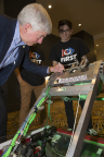 Michigan Gov. Rick Snyder signs a Detroit-based FIRST team's robot during a press event to announce the arrival of FIRST Championship in Detroit starting in 2018. (Photo: Business Wire)