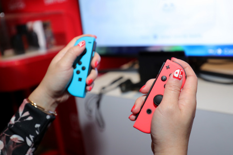 NEW YORK - JAN 13: In this photo provided by Nintendo of America, a guest enjoys playing Mario Kart 8 Deluxe on the groundbreaking new Nintendo Switch video game system at a special preview event in New York on Jan. 13, 2017. Launching March 3, 2017, Nintendo Switch combines the power of a home console with the mobility of a handheld. It's a new era in gaming that delivers entirely new ways to play wherever and whenever people want. (Photo by Neilson Barnard/Getty Images for Nintendo of America)
