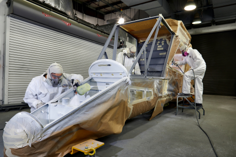 The first K-MAX® airframe produced at the Company's Jacksonville, FL facility is shown being painted ...