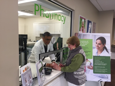 Humana Pharmacist Viren Patel consults with patient Yvonne Almeida at the Partners in Primary Care Orchard Park medical center. (Photo: Business Wire)
