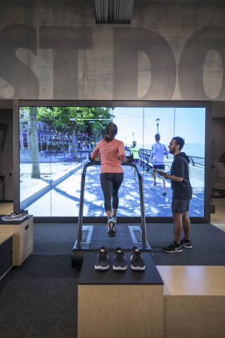 The Nike+ Running Trial Zone, located on the first floor, allows consumers to test shoes on a treadmill surrounded by two cameras capturing data from their run. (Photo: Business Wire)