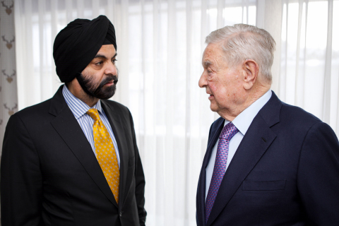 Mastercard CEO Ajay Banga and George Soros met at the World Economic Forum announcing plans to explore creating a social enterprise to apply commercial strategies to deliver a positive impact on society. (Photo: Business Wire)