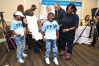 At 11 years old, Jaheim Whigham (center) is the youngest and smallest patient to receive the 50cc SynCardia temporary Total Artificial Heart. (Photo: Jan Terry, Ann & Robert H. Lurie Children's Hospital of Chicago)