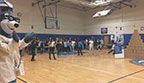 "UnitedHealthcare donated 150 NERF Energy Game Kits to the Boys & Girls Clubs of Boston as part of a national initiative to encourage young people to become more active through ""exergaming"". Beverly-Jane Perry, senior director of network programs for UnitedHealthcare, and New England Revolution president, Brian Bilello, cheered for club members as they were led through exercises with UnitedHealthcare mascot Dr. Health E. Hound and New England Revolutions midfielder, Scott Caldwell, to showcase the activity tracker and mobile game. Throughout 2017, UnitedHealthcare will deliver a total of 10,000 NERF ENERGY Game Kits to elementary schools and community organizations across the country, enabling children ages six to 12 to receive the kits at no cost (Video: Anita Sen)."