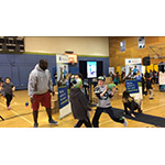 """Members of the Boys & Girls Clubs of King County participate in exercises and relays with UnitedHealthcare mascot Dr. Health E. Hound and Rees Odhiambo, Seattle Seahawks Guard, while wearing NERF ENERGY activity bands. Nearly 150 Wallingford Club members received NERF Energy Game Kits from Hasbro and UnitedHealthcare to encourage greater physical activity. The donation is part of a recently launched national initiative and collaboration between Hasbro and UnitedHealthcare, featuring Hasbro's NERF products that encourages young people to become more active through """"exergaming"""" (Video: Anita Sen)."""