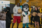 "Cindy Spain, RN, Vice President of Health Services, UnitedHealthcare Community Plan; UnitedHealthcare mascot Dr. Health E. Hound; Rees Odhiambo, Seattle Seahawks Guard; and Nancy Giunto, Executive Director, Washington Health Alliance passed out 150 NERF ENERGY Game Kits to members of the Boys & Girls Clubs of King County this morning. The local youth were led through exercises and relays to test out their new NERF ENERGY Game Kit that tracks activity earning ""energy points"" in order to play the game. The donation is part of a recently launched national initiative and collaboration between Hasbro and UnitedHealthcare, featuring Hasbro's NERF products that encourages young people to become more active through ""exergaming."" L to R: Odhiambo, Dr. Health E. Hound, Spain (Photo: Kim Doyel)."