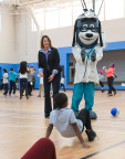 "Tracy Davidson, CEO, UnitedHealthcare Community Plan of Ohio, with mascot Dr. Health E. Hound led members of the Boys & Girls Clubs of Cleveland through exercises and relays to test out the NERF ENERGY RUSH mobile game. This afternoon, UnitedHealthcare donated 150 NERF ENERGY Game Kits. The donation is part of a recently launched national initiative encouraging young people to become more active through ""exergaming"" (Photo: Paul Silla)."