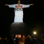 Rio de Janeiro's iconic monument Christ the Redeemer (Cristo Redentor), and ILOVERIO logo on the statue for inauguration night. (Photo: Business Wire)