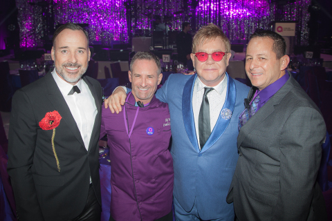 """When it comes to creating mouth-watering and inspiring cuisine for the Elton John AIDS Foundation Oscar party, """"It's a labor of love,"""" says Chef Wayne Elias, (second from left) pictured with business partner Chris Diamond (far right), co-owners of Crumble Catering and Los Feliz restaurant Rockwell: Table & Stage, joined by (l-r) David Furnish and Sir Elton John. (Photo: Business Wire)"""