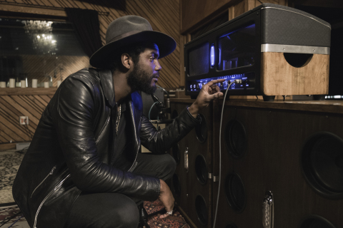Singer/songwriter Gary Clark. Jr., checks out the one-of-a-kind amp designed by Lincoln and engineered by Revel. (Photo: Business Wire)