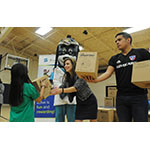 """Joanne Shuey, vice president of Sales and Account Management, UnitedHealthcare of North Texas, and FC Dallas midfielder Victor Ulloa passed out 150 NERF ENERGY Game Kits to members of the Boys & Girls Clubs of Greater Dallas this afternoon. The kids were led through exercises and relays to test out their new NERF ENERGY Game Kits that track activity earning """"energy points"""" in order to play the game. The donation is part of a recently launched national initiative and collaboration between Hasbro and UnitedHealthcare, featuring Hasbro's NERF products, that encourages young people to become more active through """"exergaming"""" (Photo: Juan Garcia)."""