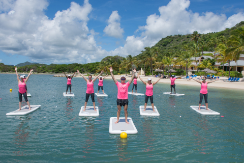 A Floatfit® CARIBBEAN aquabase® class being held on Mamora Bay at St. James's Club & Villas in Antigua. Photo credit: Casey Omar Jerson