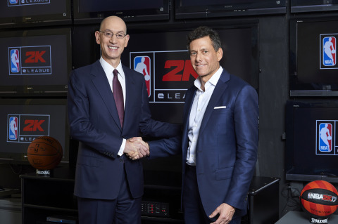 Take-Two CEO Strauss Zelnick, right, joins NBA Commissioner Adam Silver, left, at the league's headq ...