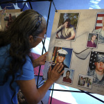 """Pictured is a heartfelt moment captured during the """"Remembering Our Fallen"""" traveling exhibit organized by Omaha, Nebraska-based non-profit Patriotic Productions that recognizes the Fallen who have died in The War on Terror since September 11, 2001. Initially focused on those Fallen that called Nebraska home, the exhibit has expanded to 19 states, with a national memorial unveiling scheduled for September 7 - 9, 2017, in Washington D.C. JQH's Embassy Suites by Hilton Omaha - La Vista Hotel & Conference Center in Nebraska is pleased to continue collaborating with Patriotic Productions to support veterans initiatives, including the """"Remembering Our Fallen"""" memorial and the Vietnam Veterans Flight - 2017: """"The Final Mission."""" Photo Source: Patriotic Productions"""