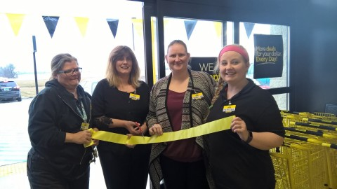 Dollar General employees in Hankinson, North Dakota celebrate the store's grand opening on Saturday, ...