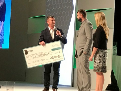 Jeff Acuff, Senior Vice President US Sales, Bioventus Active Healing Therapies, Presents $10,000 Check to Gregory Gudenkauf and Christine Blankmeyer of Opportunity Village (Photo: Business Wire)
