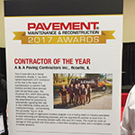 Todd Eichholz and Bob Olson, A&A Paving Co-owners, accept National Contractor of the Year Award at the 2017 National Pavement Expo (Photo: Business Wire)