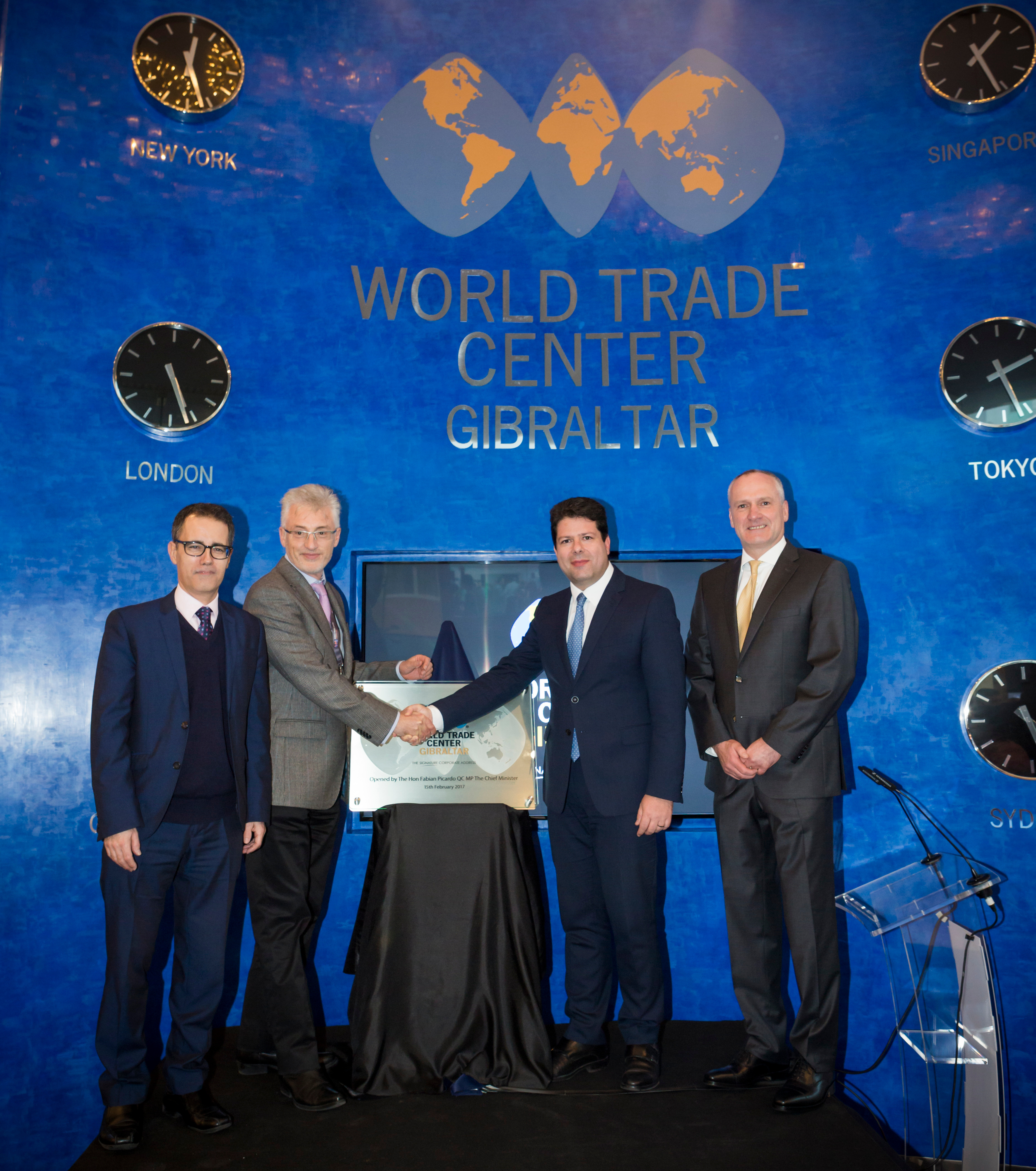 Developer Gregory Butcher shakes hands with Chief Minister Fabian R Picardo QC MP at the inauguration of World Trade Center Gibraltar (Photo: Business Wire)