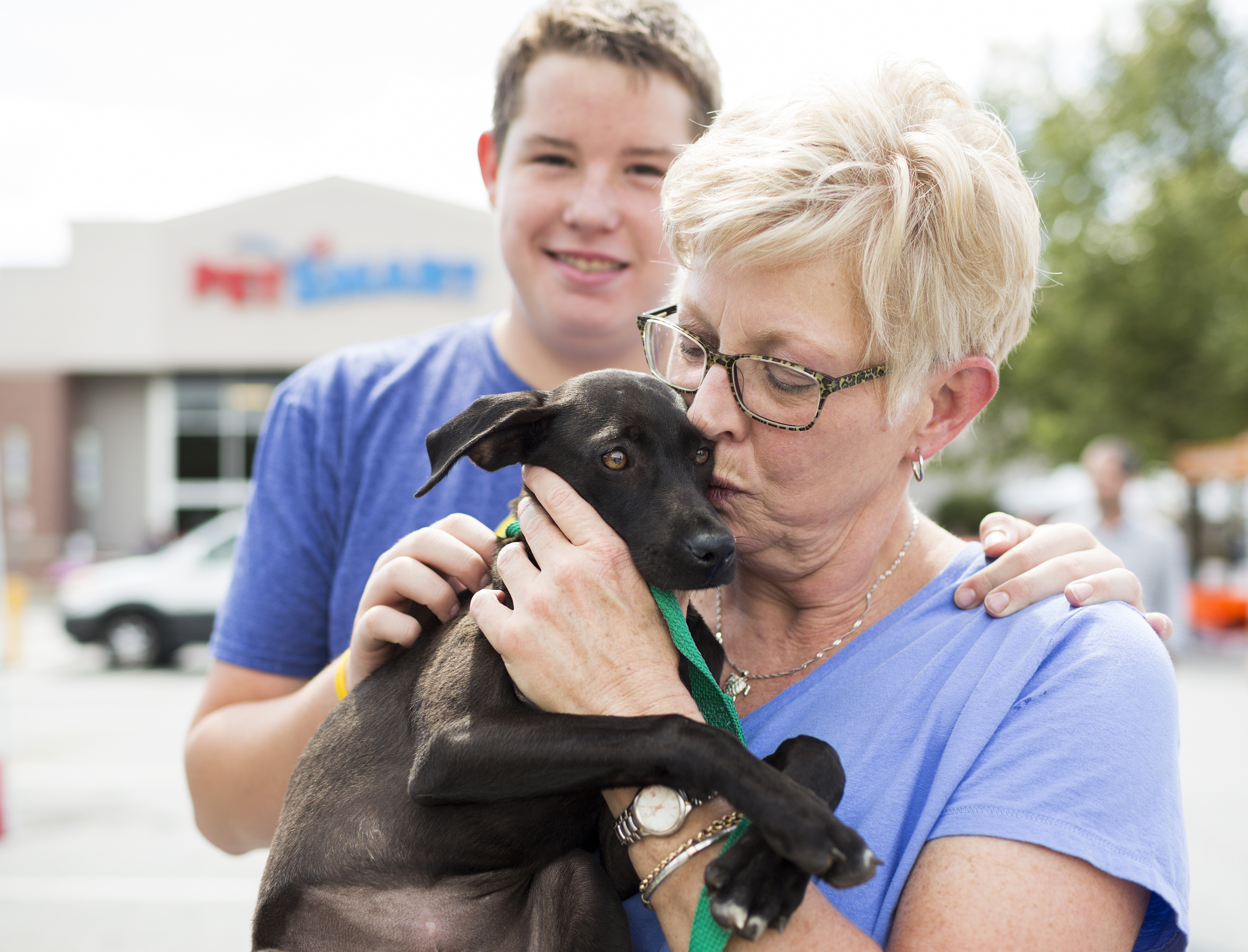 The Ballards give love to their new family member, Kate, who was adopted from a local PetSmart in Ashville, N.C., during a National Adoption Weekend event. PetSmart's first National Adoption Weekend of 2017 is being held at 1,500-plus PetSmart stores across North America this weekend, Feb. 17-19. (Photo: Business Wire)
