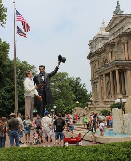 """© 1991, 2014 The Seward Johnson Atelier, Inc. Photo by Heather Taylor. The 30 foot tall bronze sculpture """"Return Visit"""" shown here on exhibition in Troy, Ohio."""