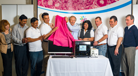Consulting CMO Dr. Clive Taylor unveiling the new 'OS-FL' Fluorescent OptraSCAN Scanner (Photo: Business Wire)