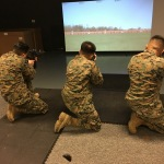 Three U.S. Marines at Camp Upshur, Marine Corps Base Quantico, use the new Indoor Simulated Marksmanship Trainer (ISMT) on January 27, 2017. The first three sites to receive ISMT from Meggitt Training Systems are Camp Upshur, The Basic School, and Weapons Training Battalion. All 670-plus ISMT system deliveries should be completed during the next 18 months. (Photo: Business Wire)