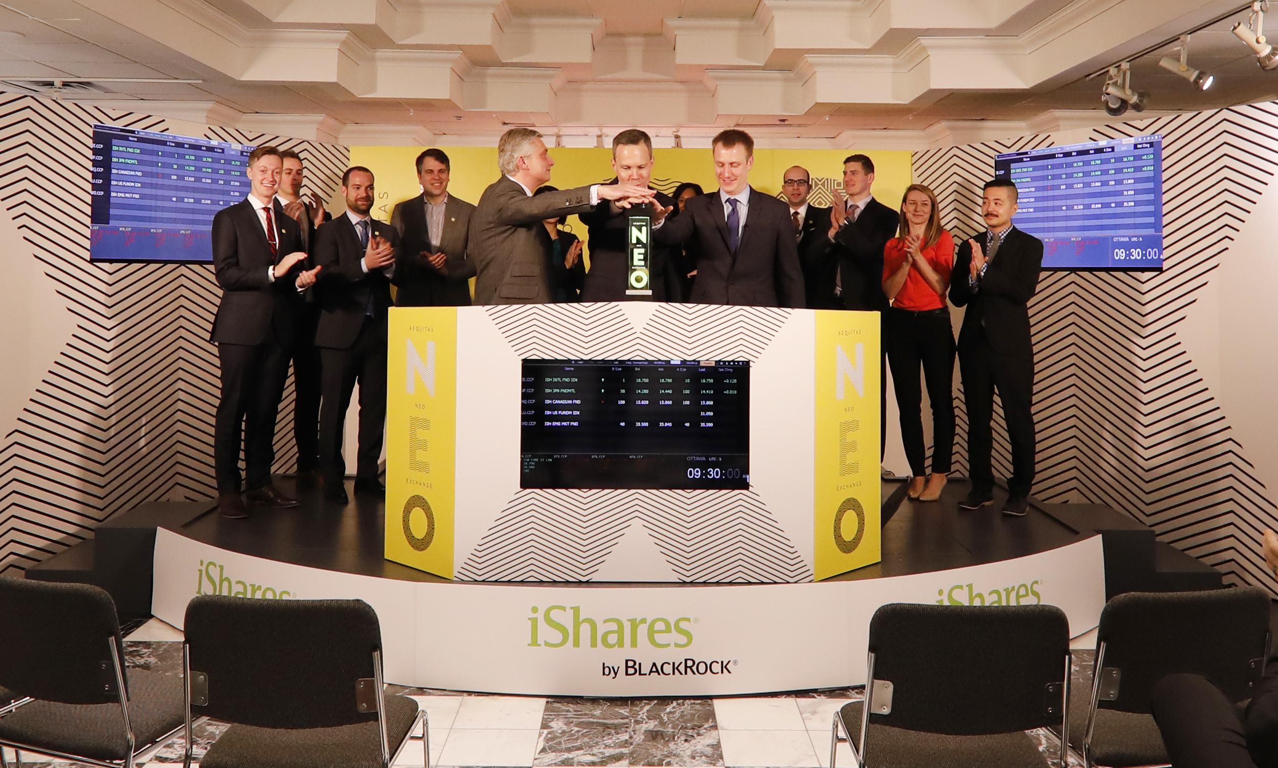 """BlackRock Asset Management Canada Limited (""""BlackRock Canada""""), including Head of iShares, Warren Collier, joined Jos Schmitt, President and Chief Executive Officer, Aequitas NEO Exchange Inc. (""""NEO Exchange""""), to open the market to launch select iShares exchange-traded-funds (ETFs). BlackRock Canada is a global leader in investment management, risk management and advisory services for institutional and retail clients. The select iShares ETFs migrated from the Toronto Stock Exchange and commenced trading on the NEO Exchange on February 22, 2017. The launched ETFs include common units and advisor class units of the following iShares Funds: iShares Canadian Fundamental Index ETF (CRQ, CRQ.A); iShares Emerging Markets Fundamental Index ETF (CWO, CWO.A); iShares International Fundamental Index ETF (CIE, CIE.A); iShares Japan Fundamental Index ETF CAD-Hedged (CJP, CJP.A), and; iShares US Fundamental Index ETF (CLU, CLU.A, CLU.B, CLU.C). (Photo: Business Wire)"""