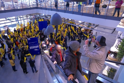 Coworkers greet Daniel Perez and Kelly King, the first customers at IKEA Renton, during the grand opening of the Swedish retailer's relocated Seattle store on Wednesday, February 22. (Photo: Business Wire)