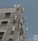 WHO's International Agency for Research on Cancer calls the radiation emitted by telecommunications antennas a Group 2B 'Possible Carcinogen,' but antennas keep going up on residential buildings, benefiting owners while risking the health of residents. (Photo: Business Wire)