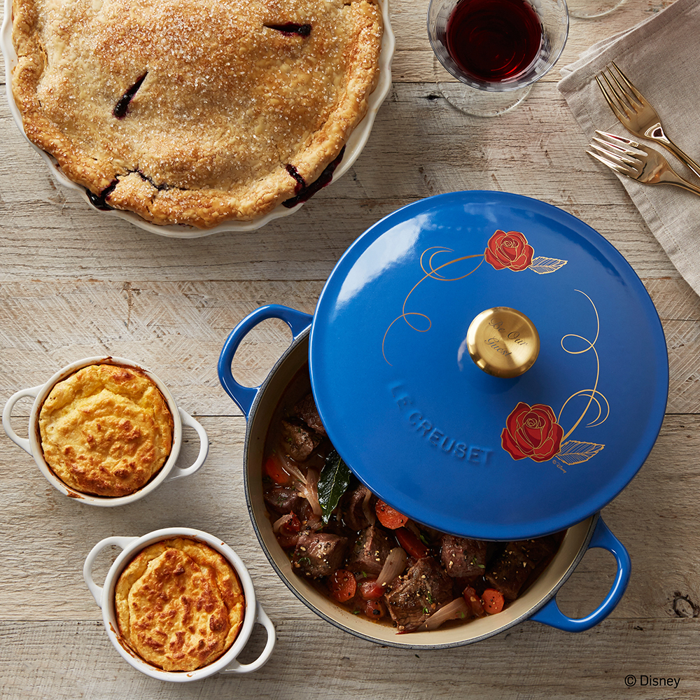 "Created in honor of Disney's live-action adaptation of Beauty and the Beast, this vibrant blue-enameled soup pot by Le Creuset casts an enchanting spell over the kitchen. Featuring an iconic red rose design and a golden knob engraved with ""Be Our Guest,"" this special-edition piece is available in limited quantities. (Photo: Business Wire)"