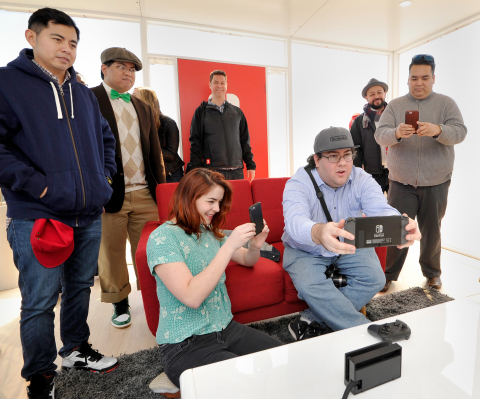 In this photo provided by Nintendo of America, local fans play The Legend of Zelda: Breath of the Wild on the Nintendo Switch system while it is in handheld mode in the California desert on February 23, 2017 at Blue Cloud Movie Ranch in Santa Clarita, California. (Photo by John Sciulli/Getty Images for Nintendo of America)