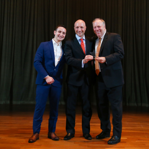 """RCOM & GCX CEO Bill Barney and GCX APAC President Fabrizio Civitarese, receiving the """"Excellence in Connectivity for Data Centers"""" Award from Marcello Brescia of BroadGroup. (Photo: Business Wire)"""