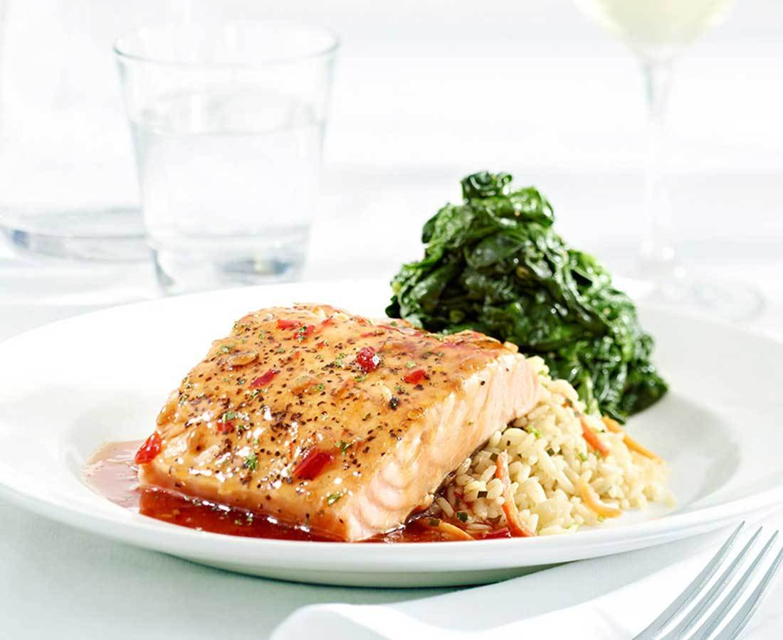 """Grilled Scottish Salmon - Szechuan style or """"naked,"""" served with jasmine rice and sautéed spinach (Photo: Business Wire)"""