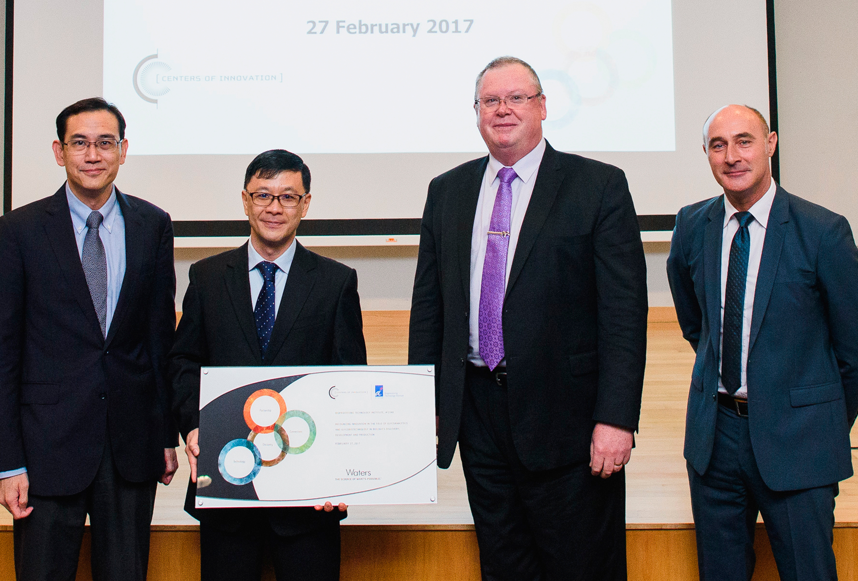 In a ceremony today, Singapore's Bioprocessing Technology Institute joined the Waters Centers of Innovation Program. On hand for the event were (l. to r.) Dr. Benjamin Seet, Executive Director, Biomedical Research Council, Agency for Science, Technology and Research, Singapore; Professor Kong Peng Lam, Executive Director, Bioprocessing Technology Institute (BTI); Eric Fotheringham, Senior Director – Waters Centers of Innovation Program; and Mathieu Laouenon, General Manager, South Asia, Waters Corporation. (Photo: Business Wire)