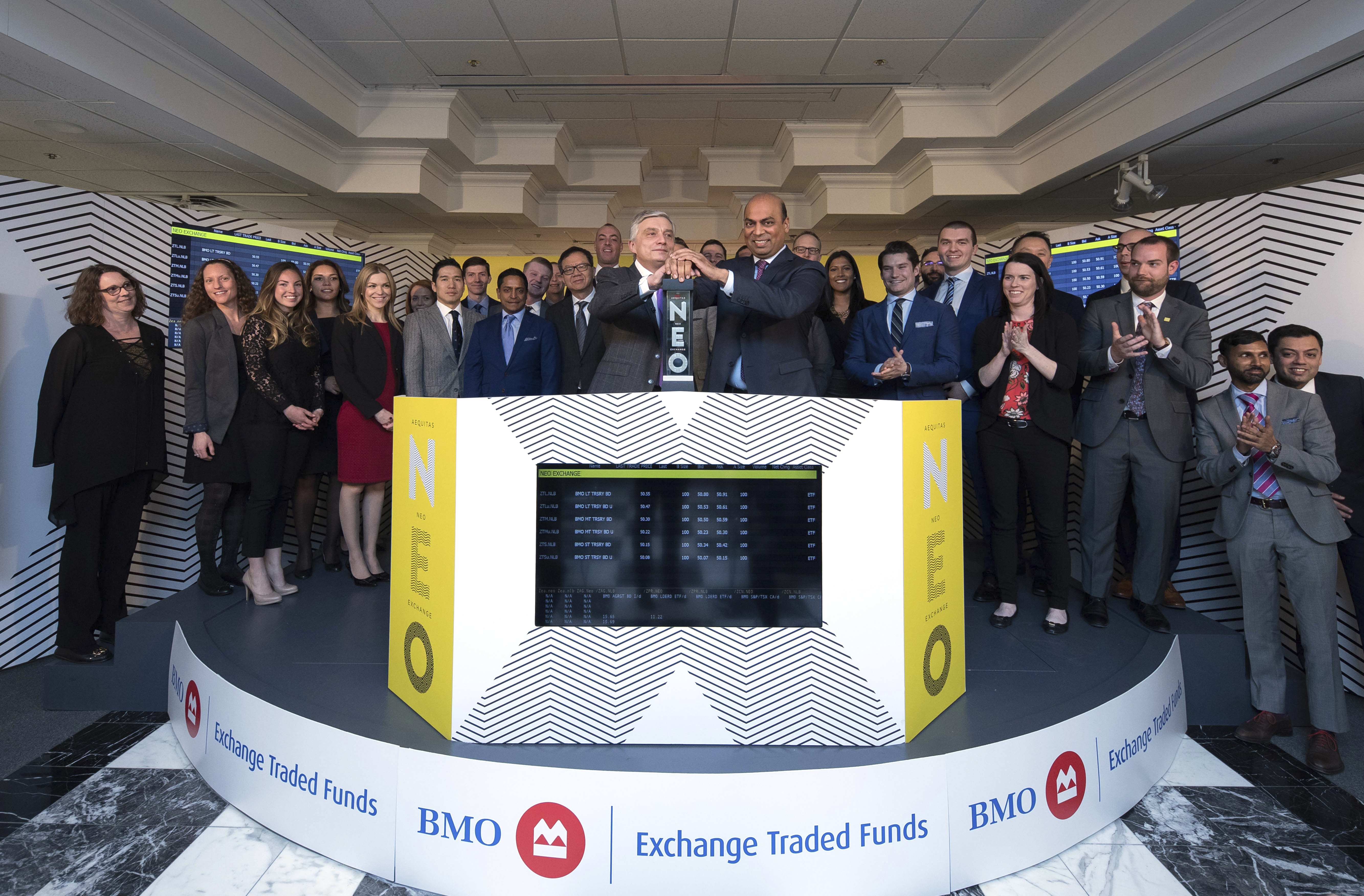 "Kevin Gopaul, Head, BMO Global Asset Management Canada, Global Head of ETFs and Chief Investment Officer, BMO Asset Management Inc. (""BMO AM""), joined Jos Schmitt, President and Chief Executive Officer, Aequitas NEO Exchange Inc. (""NEO Exchange""), to open the market, marking the launch of six BMO exchange-traded-funds (ETFs) that began trading on the NEO Exchange today. Established in June 2009, BMO Financial Group's ETF business is a leading ETF provider in Canada. The six U.S. Treasury funds include: BMO Long-Term US Treasury Bond Index ETF (ZTL, ZTL.U); BMO Mid-Term US Treasury Bond Index ETF (Ticker: ZTM, ZTM.U), and; BMO Short-Term US Treasury Bond Index ETF (ZTS, ZTS.U). (Photo: Business Wire)"