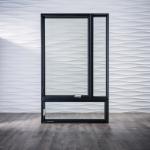 Product: Architect Series Contemporary casement window Material: Wood Finish: Black Hardware Finish: Polished Chrome (Photo Credit: Pella)