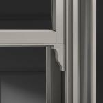 Product: Sash lug on Architect Series Reserve Double-Hung Window with putty glaze profile Material: Wood Finish: Portobello (Photo Credit: Pella)