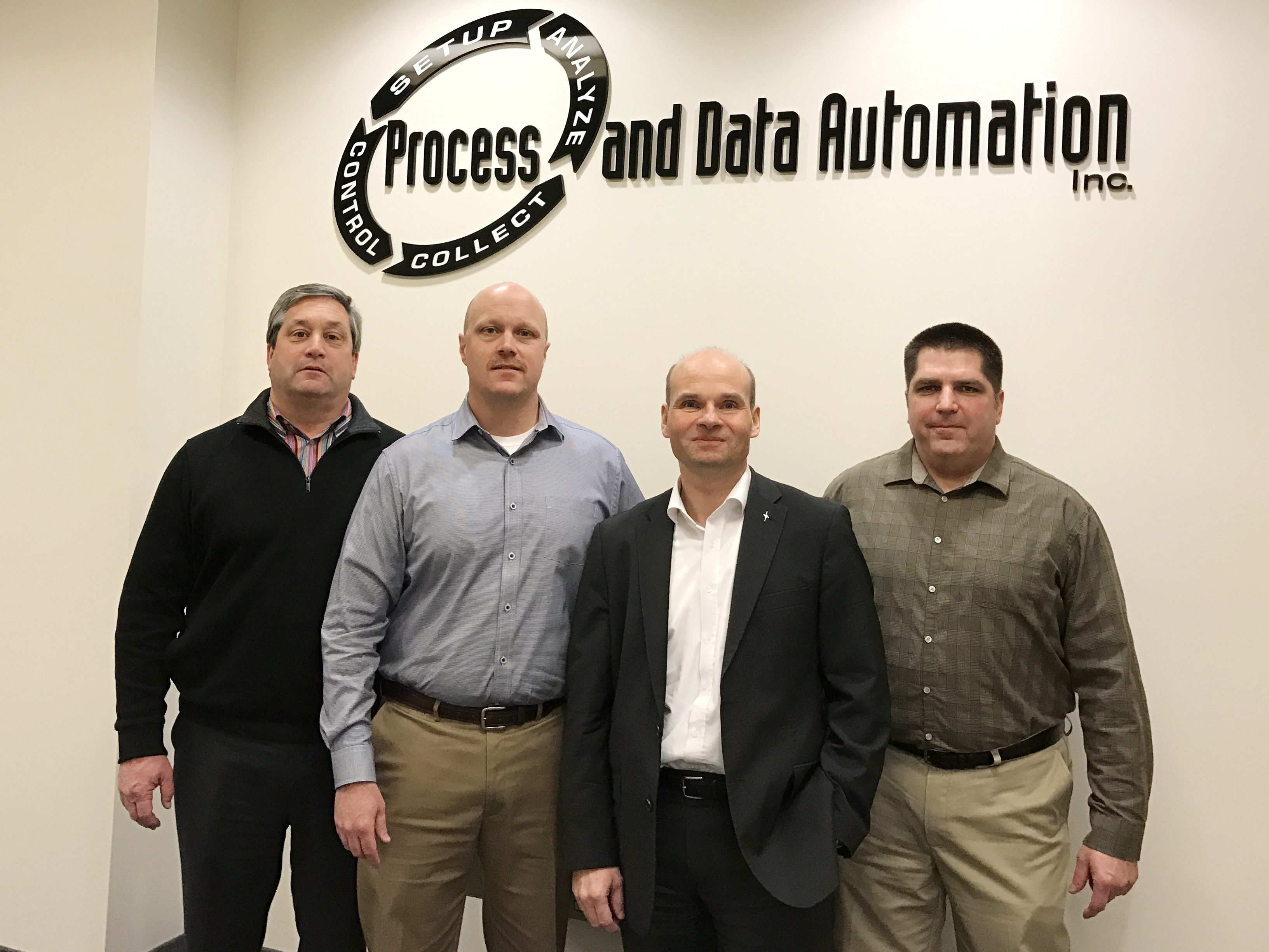 From left to right: Tim Raymond, Executive Vice President, Sales and Marketing, Krones Inc., Joseph Snyder, President, Process and Data Automation, Holger Beckmann, Chief Executive Officer, Krones Inc., Michael Benedict, Vice President, Process and Data Automation (Photo: Krones Inc.)