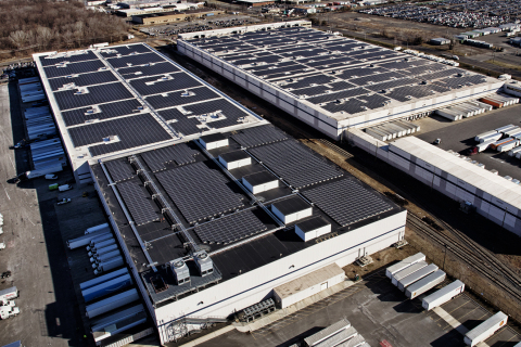 Aerial view of two Amazon fulfillment facilities with solar systems on their rooftops. Photo credit: P2 Photography.