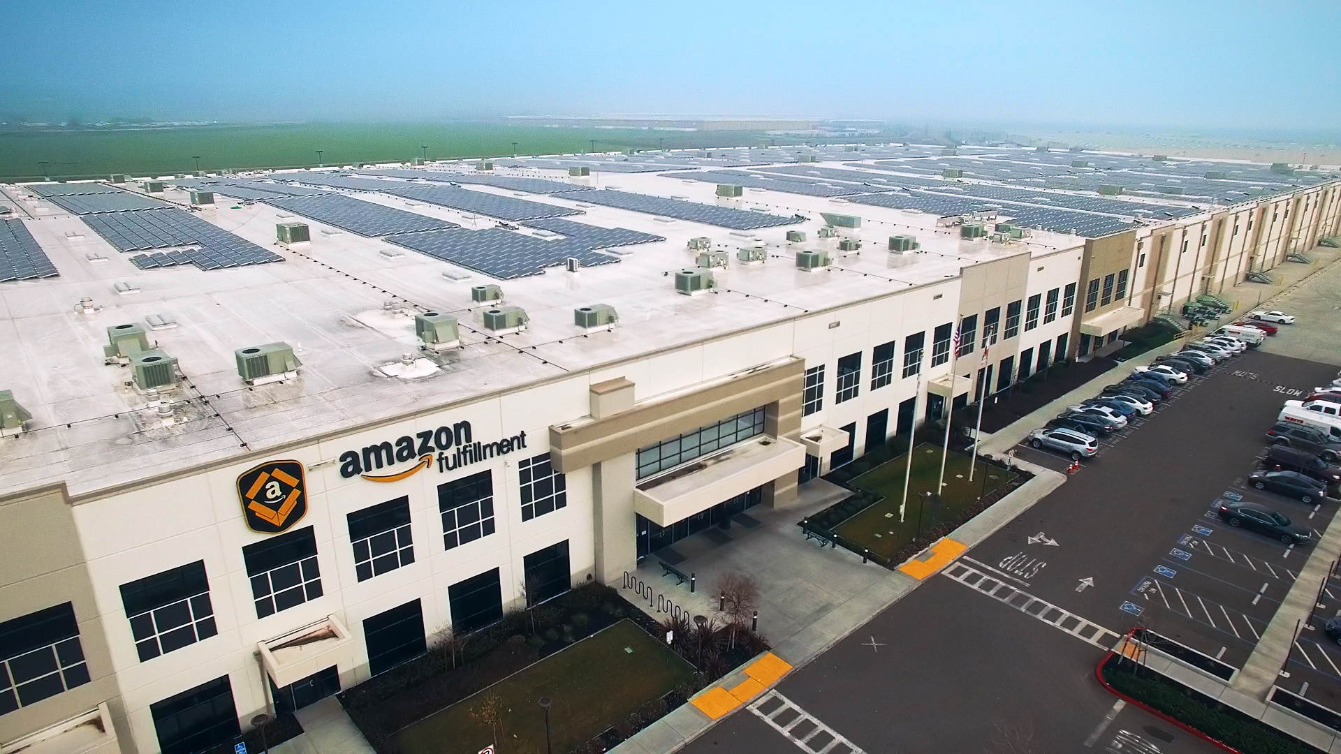 Aerial view of Amazon fulfillment center with solar systems on its rooftop. (Photo: Business Wire)