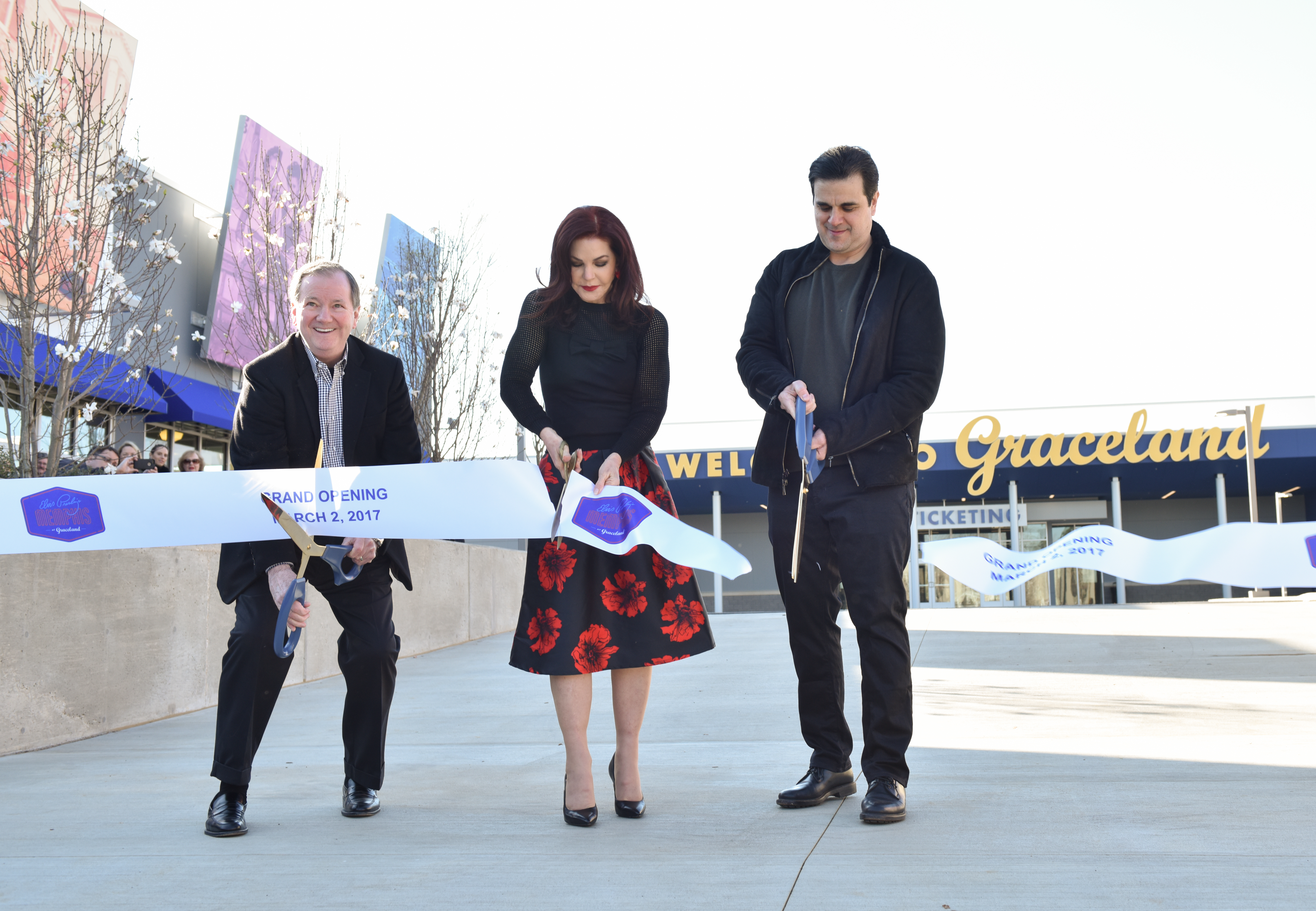 From left to right: Elvis Presley Enterprses CEO Jack Soden, Priscilla Presley and Graceland Holdings LLC Managing Partner Joel Weinshanker cut the ribbon to open the new Elvis Presley's Memphis Entertainment Complex at Graceland. (Photo: Business Wire)