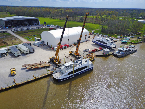 The first CityWide Ferry in the water at Metal Shark's Franklin, Louisiana shipyard, with the second vessel awaiting its turn at the cranes. (Photo credit: Workboat)