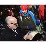 In this photo provided by Nintendo of America, Doug Bowser, Senior Vice President Sales and Marketing, greets eager fans lined up outside the Nintendo NY store on March 3. (Photo: Nintendo of America)