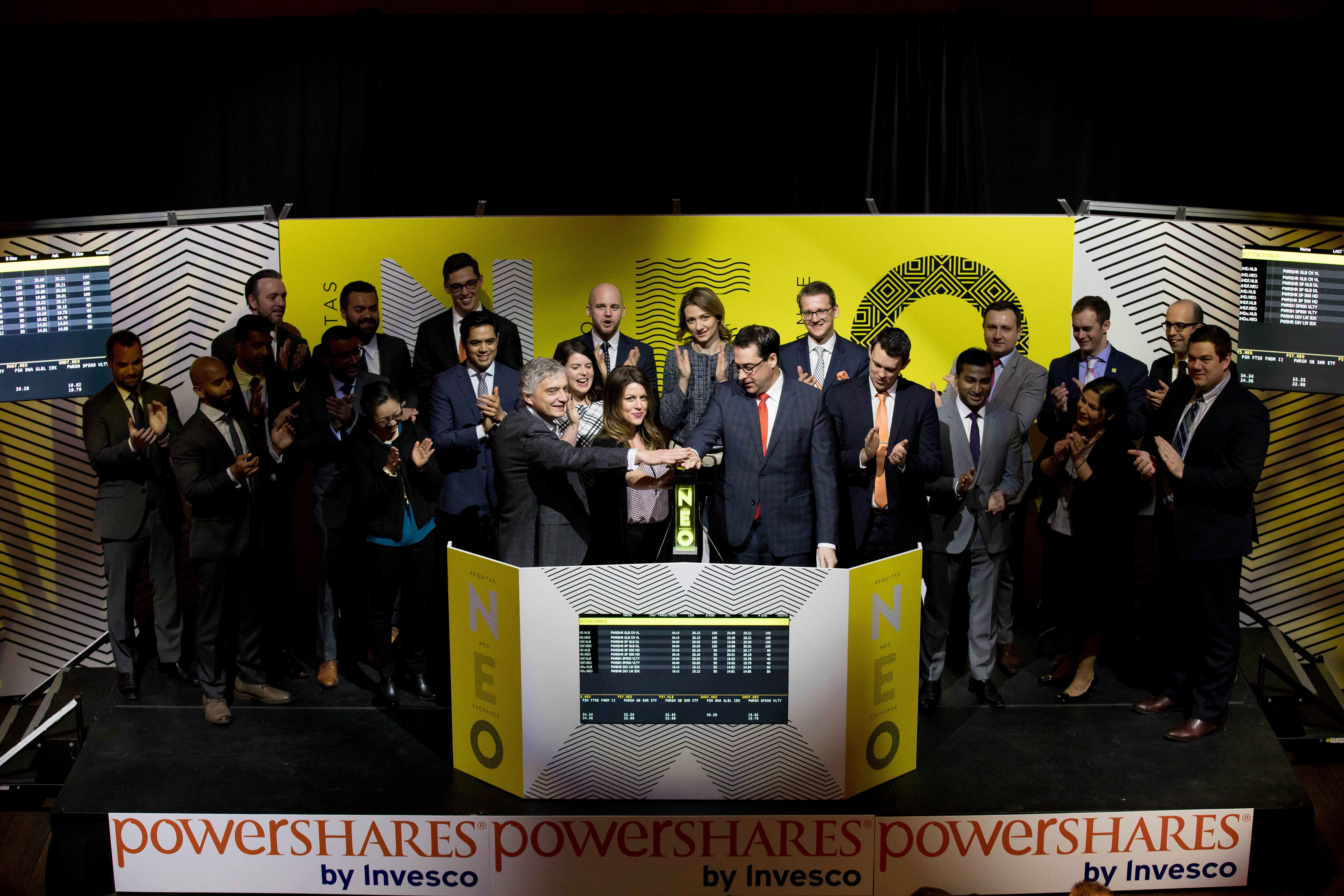 """Invesco Canada Ltd. (""""Invesco""""), including PowerShares Canada Vice President of Product and Business Development, Christopher Doll, joined Jos Schmitt, President and Chief Executive Officer, Aequitas NEO Exchange Inc. (""""NEO Exchange""""), to open the market in celebration of two new PowerShares exchange-traded-funds (ETFs), representing five ticker symbols, launching on the NEO Exchange. PowerShares ETFs seek to outperform traditional benchmark indexes while providing advisors and investors access to an innovative array of focused investment opportunities. The two high-dividend, low-volatility PowerShares ETFs commenced trading on the NEO Exchange on March 7, 2017. The two new funds are PowerShares S&P 500 High Dividend Low Volatility Index ETF (UHD, UHD.U, UHD.F) and PowerShares S&P Global ex. Canada High Dividend Low Volatility Index ETF (GHD, GHD.F). (Photo: Business Wire)"""